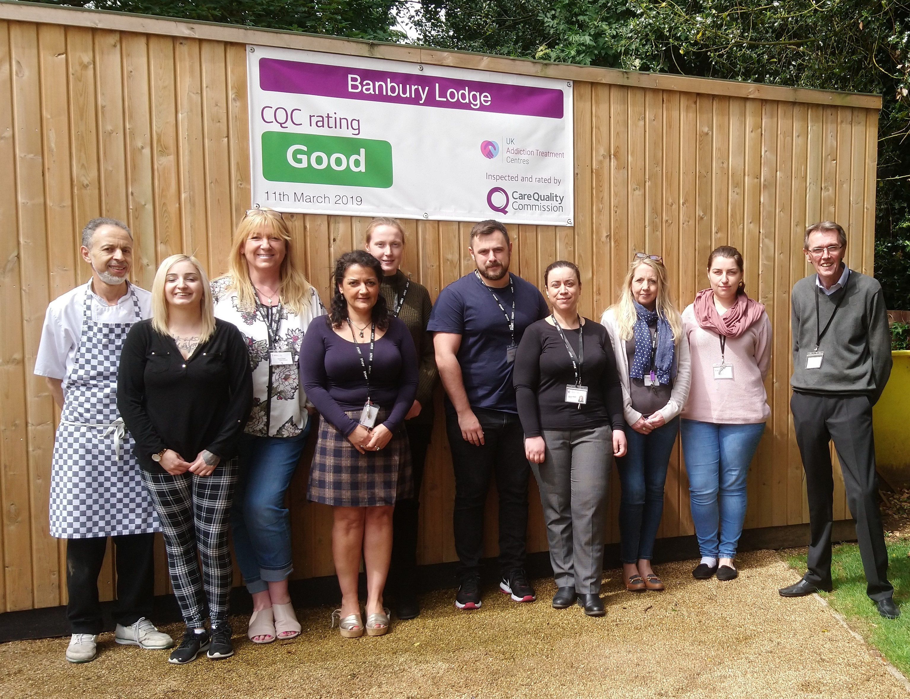 banbury lodge team holding cqc result banner